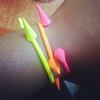 The Curvy Socialite sports  Shopbevel's Neon Spike Bangles