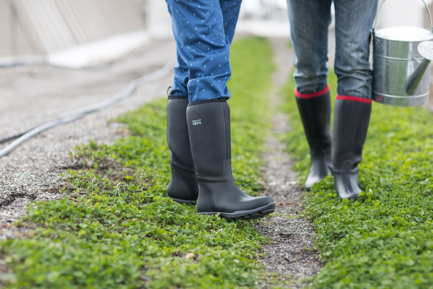 The Muck B 1802 boots come in two styles: black with red trim and black with grey trim.